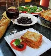 table_with_lasagna_and_a_bottle_of_wine