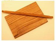 a_wooden-pastry_board_with_rolling_pin